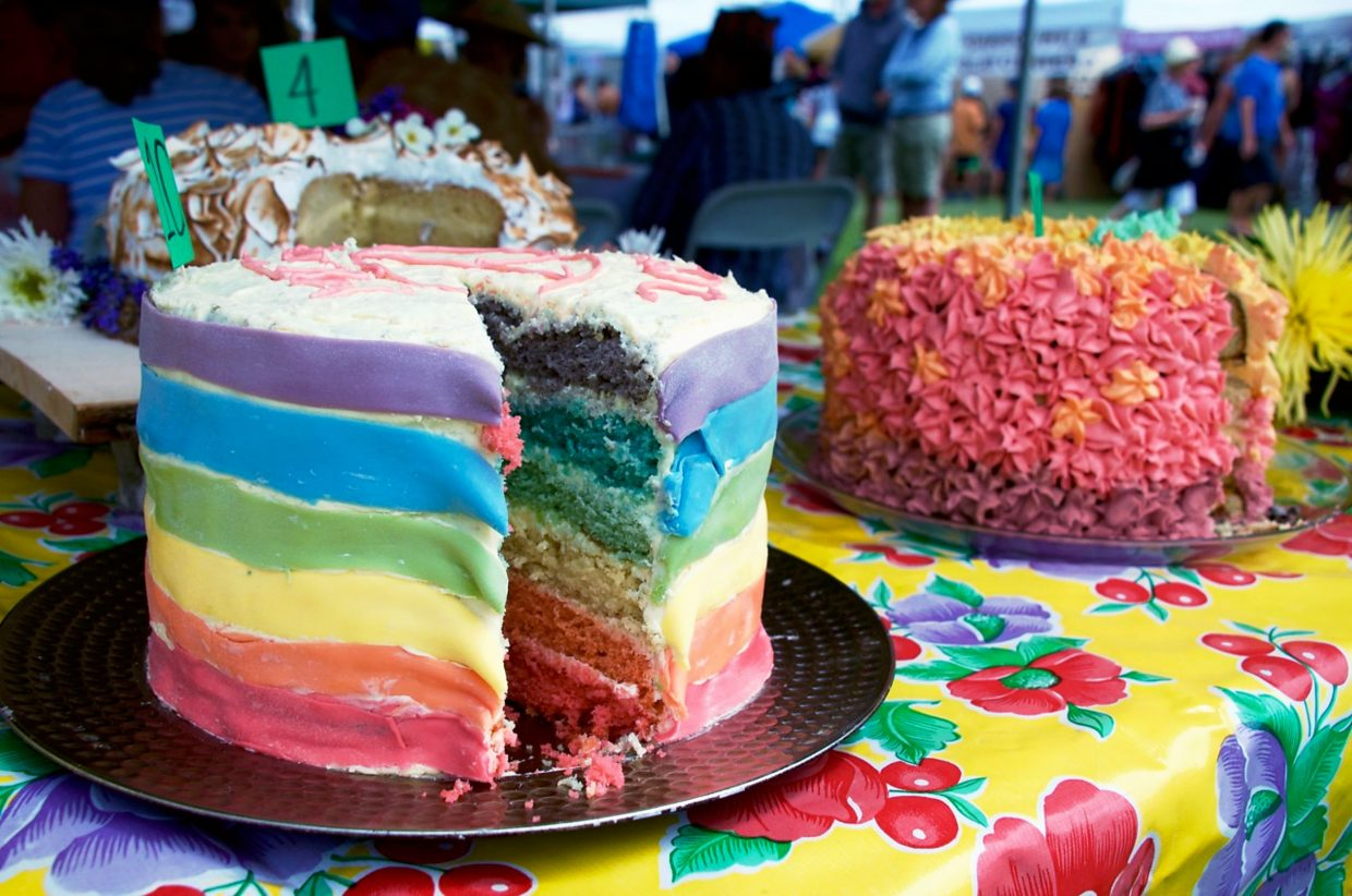 Colorful cake is cut to be judged at Mountain Fair.