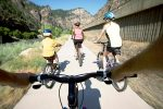 Cyclists enjoy a stretch of the Colorado River while riding the Glenwood Canyon Trail.