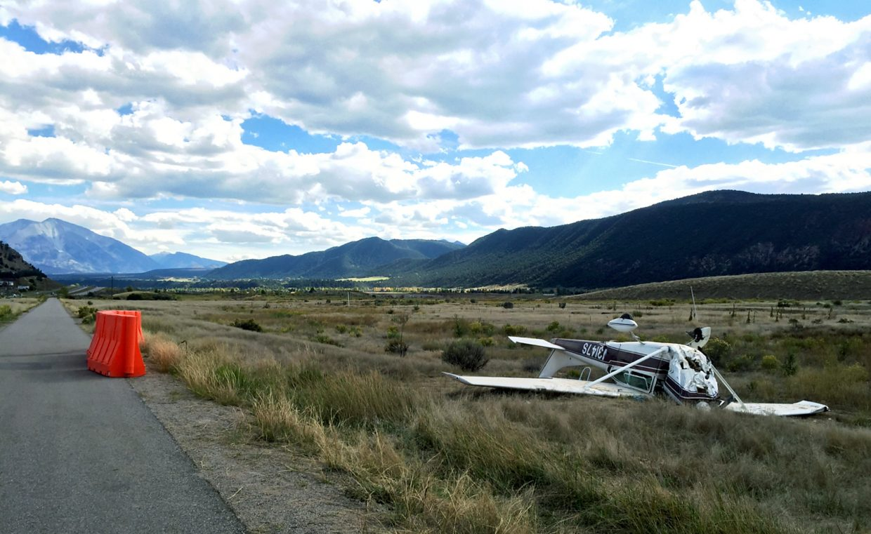 The wrecked Cessna rests upside down Monday awaiting crews that disassembled it to haul it away.