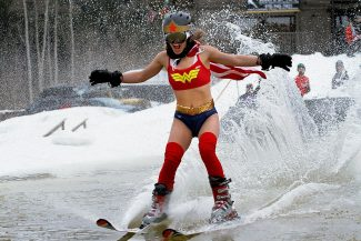 Christopher Mullen Post IndependentJasmine Van't Hoff skims across an ice cold pond, at the Beach Party Pond Skim Spectacular at Sunlight mountain March 30. Jasmine Van't Hoff won the best costume award as Wonder Woman and successfully made it across the pond twice, Sunlight will reopen for the weekend of April 5-6.
