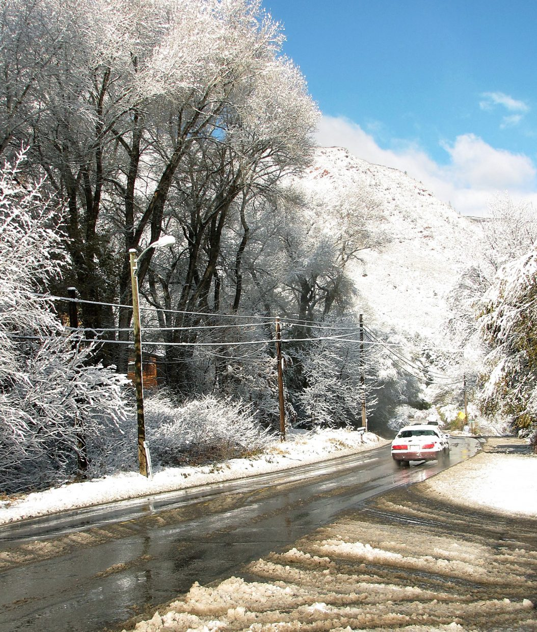 The snow overnight left a beautiful mess Wednesday morning on Midland Avenue in South Glenwood Springs.