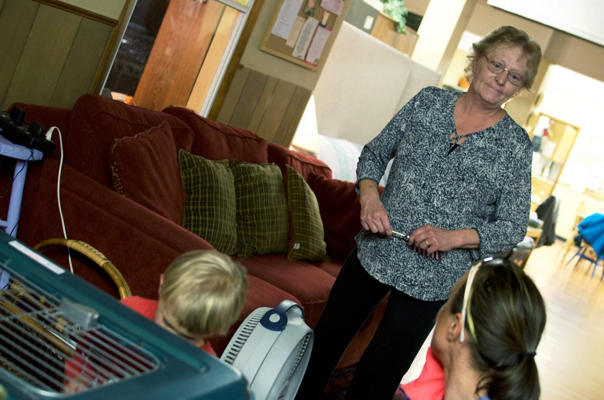 Karen Peppers talks with Kelley Cullen who brings her two young children, Ashley, 6, and Brodie, 3, to the Feed My Sheep day center once a week for volunteer work and socializing.