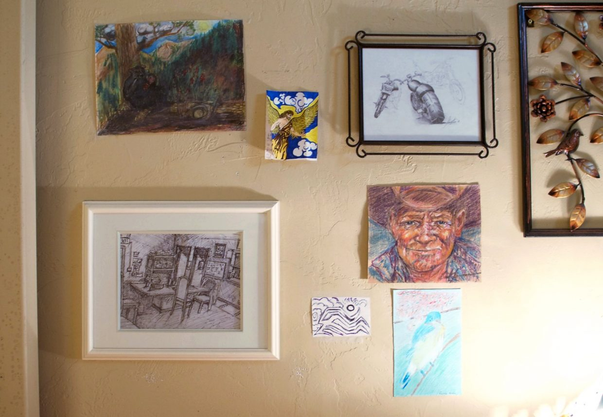 Karen Peppers' office is full of art made by patrons of the shelter.