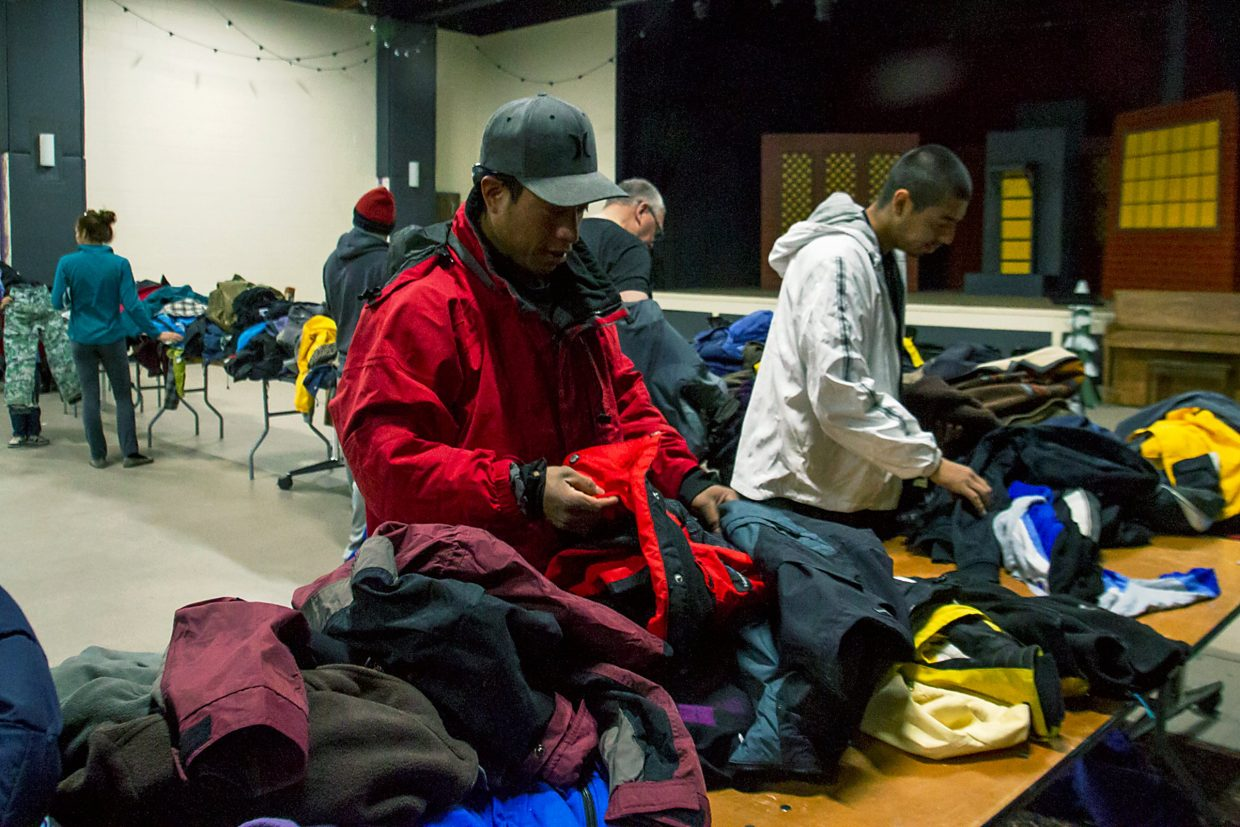People browse donated coats Saturday at the Roaring Fork Recoat annual event at Carbondale's Third Street Center. The giveaway continues from 10 a.m.-2 p.m. today.