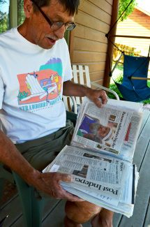 Bob Willey of Glenwood Springs flips through a scrapbook of articles he's kept from previous runnings of the Strawberry Shortcut at his West Glenwood home in this photo taken on June 18 of last year. Willey, who had run in all but one of the previous 35 Shortcuts prior to last year's race, is recovering from a stroke he suffered last month after he was diagnosed with lung cancer.