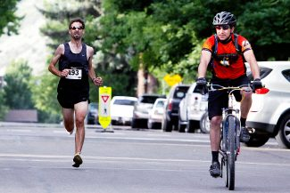 Adam Rich of Colorado Springs runs behind a pace bike as he approaches  the finish line during the 37th annual Strawberry Shortcut 10K in Glenwood Springs earlier today. Rich won with a time of 32 minutes, 2 seconds, and also won the 5K.
