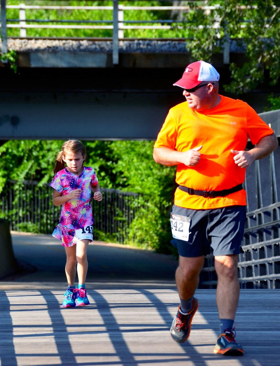 Ray Lackey and his 6-year-old daughter Kimberly Lackey came from Silt to run in the FireKracker 4k. This was one of many races for Kimberly, who also ran the Strawberry Shortcut 10k this year.