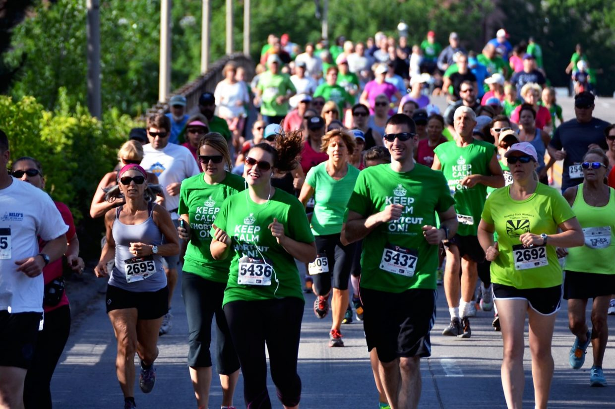 Runners cross the Grand Avenue bridge during the Strawberry Shortcut 5k run on Sunday.