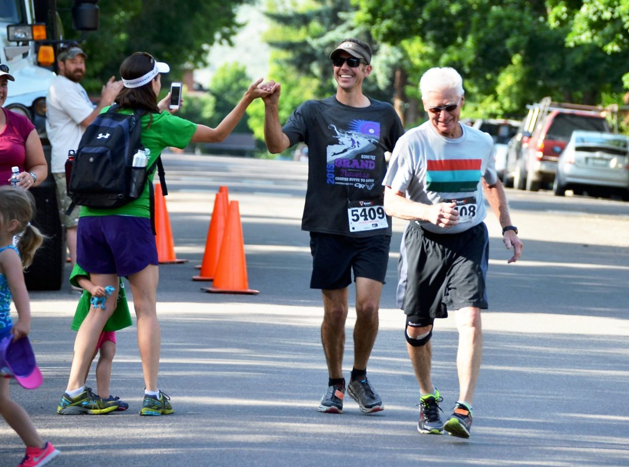 John Patrick (behind) finishes the Strawberry Shortcut 10k with his father-in-law John Sherman on Sunday afternoon. Sherman, 78, has run the Shortcut for almost 25 years.