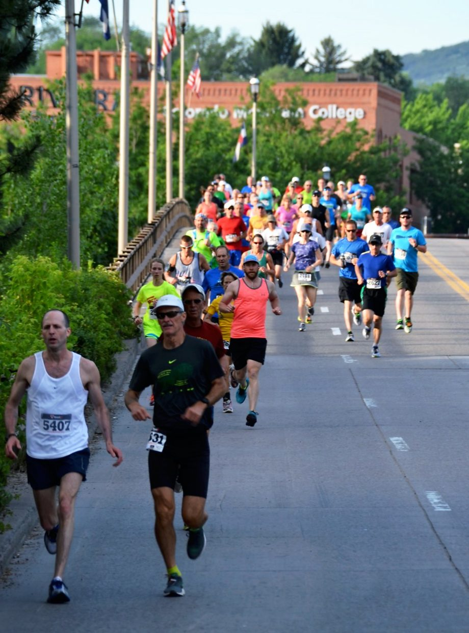 Runners cross the Grand Avenue bridge during the Strawberry Shortcut 10k run on Sunday morning.