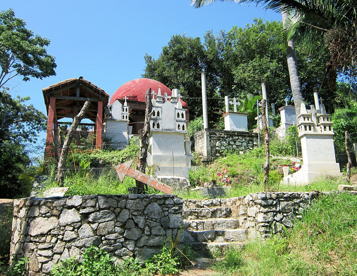 A beautiful graveyard is seen along the road to Playa de Los Muertos. Offers were left by gravesites including candles, food and beer.