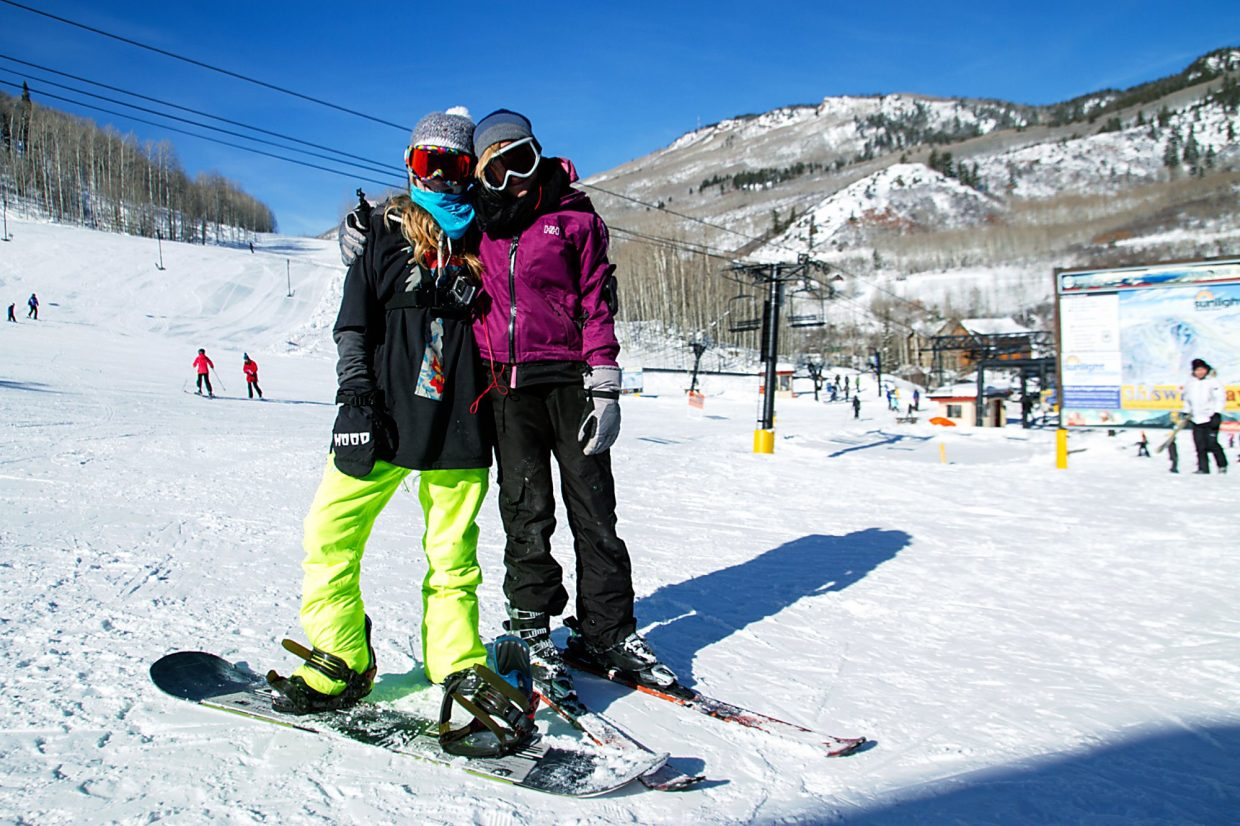 Friends Kierria Bohochik (snowboarder) and Peyton Garrison (skier) enjoy a Colorado bluebird day on the slopes at Sunlight Mountain Resort.