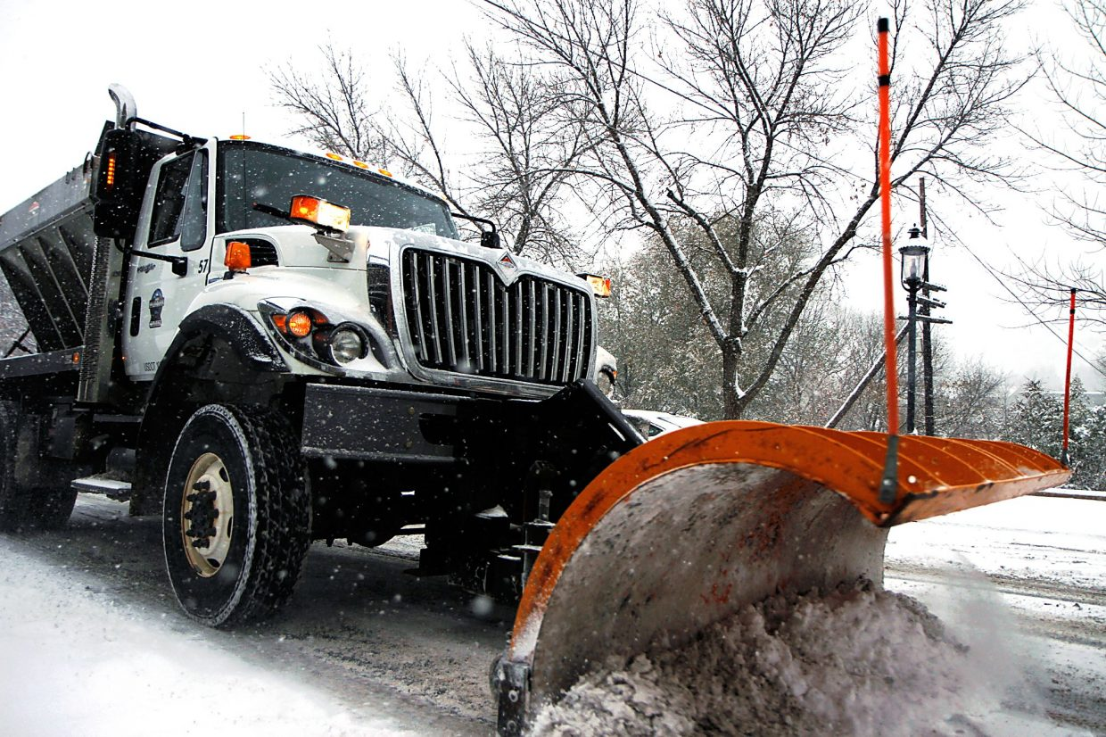 Christopher Mullen Post Independent A snowplow from the City of Glenwood Springs clears snow off 7th Street, November 13.