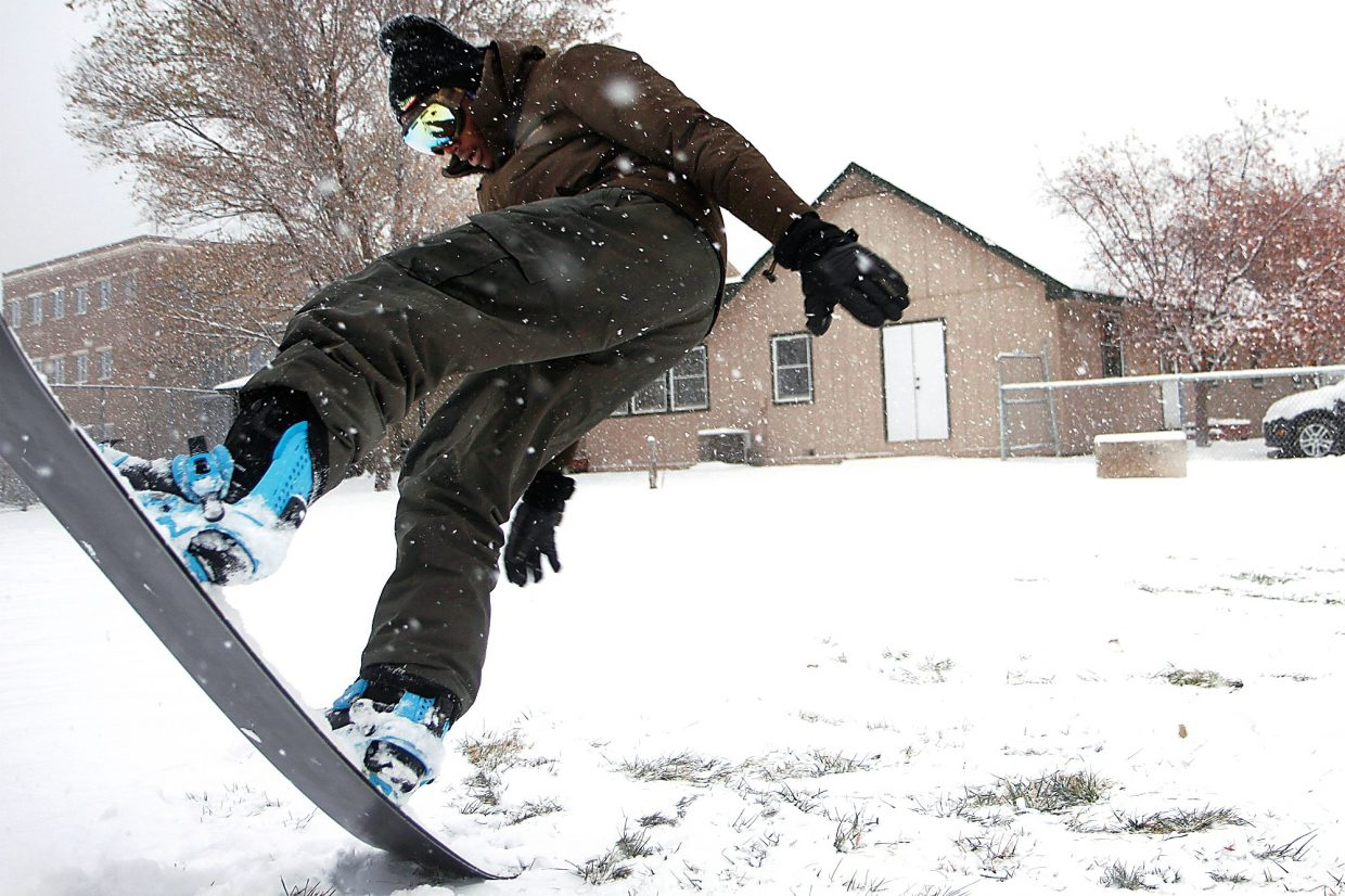 Christopher Mullen Post Independent Mark A. Francis practices tricks on his snowboard, at the baseball field next to Glenwood Springs Elementary School, November 13.
