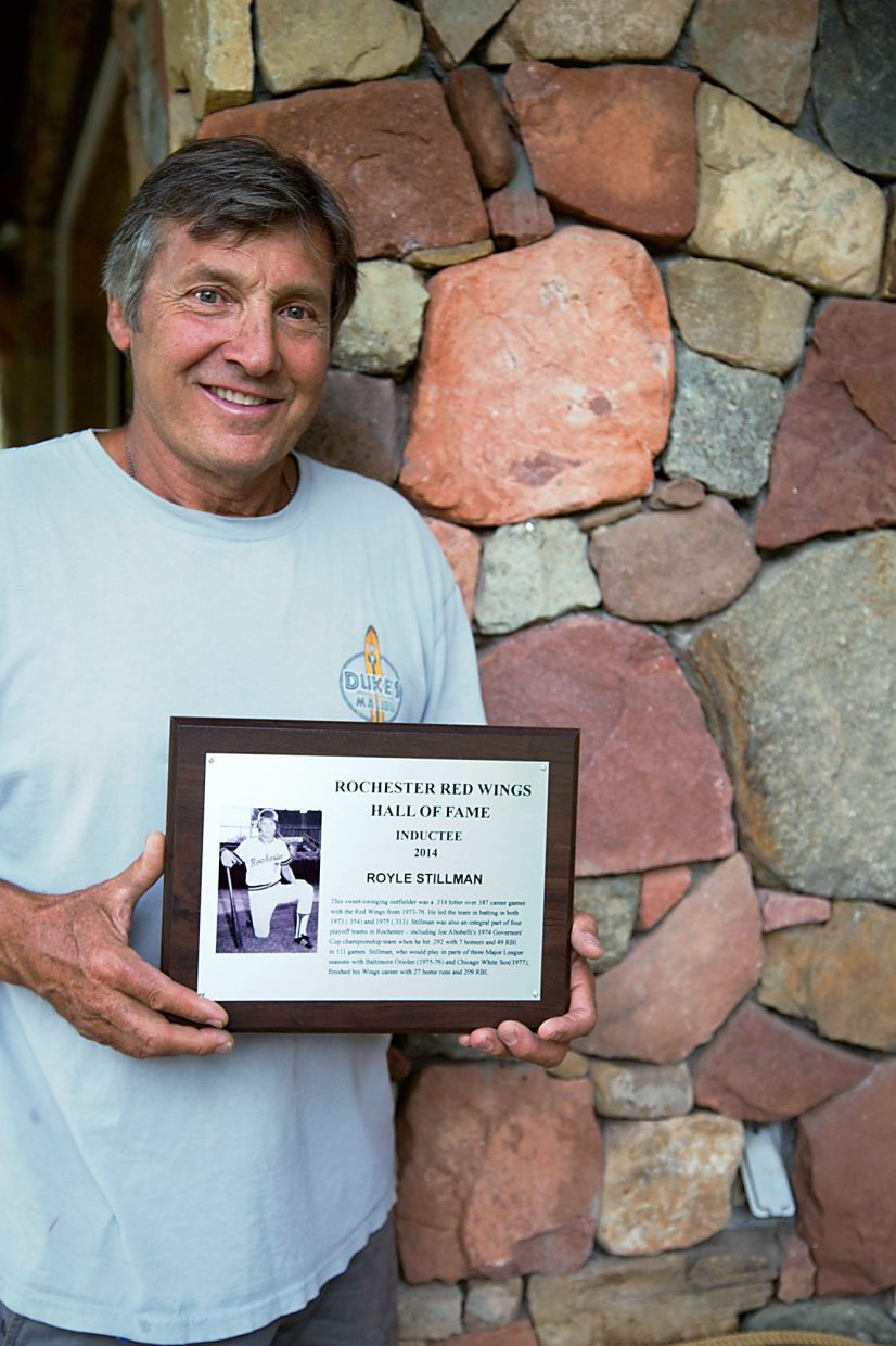 Royle Stillman proudly holds his plaque for being inducted into the Red Wings' Hall of Fame.