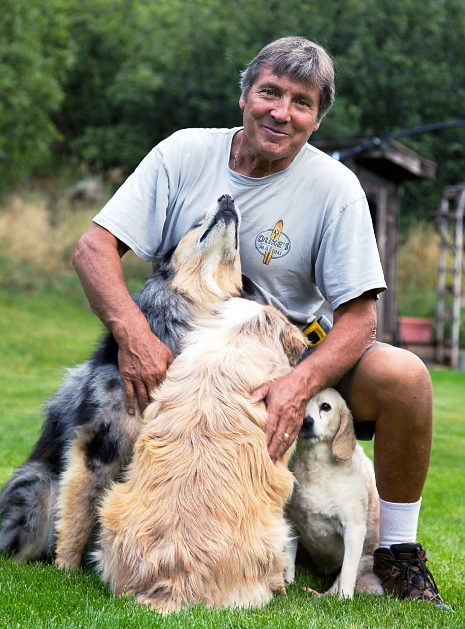 Royle Stillman with his dogs Zado (left), Naula (middle) and Bella (right).