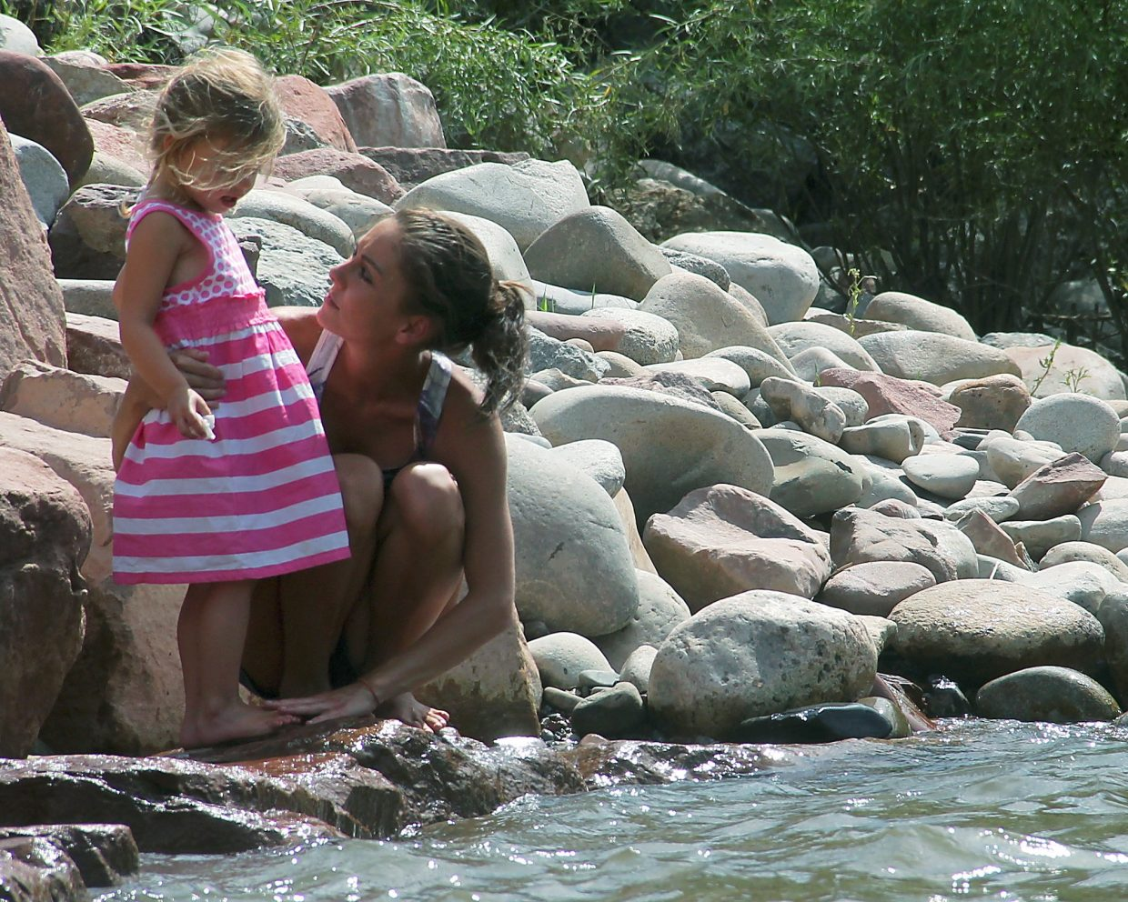 Kim Ziegler and her daughter Keira watch the action at the Wave in Glenwood Springs.