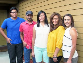 This 2014 photo, Marissa Molina, center, is shown with her family, from left, brother Jose, father Carlos, mother Marisela and sister Gabriela.