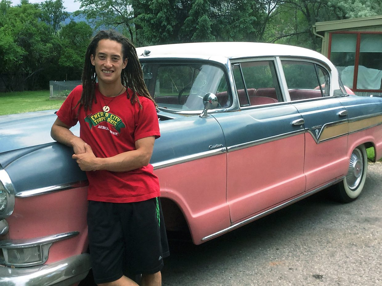 Jordan Tribble stands by his vintage 1956 custom Hudson Hornet at his family's home near Carbondale, where he was visiting last week before joining a circus in Japan.
