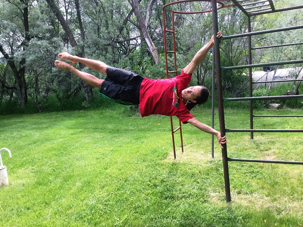 Jordan Tribble demonstrates a little acobatic skill at his family's home near Carbondale this week.
