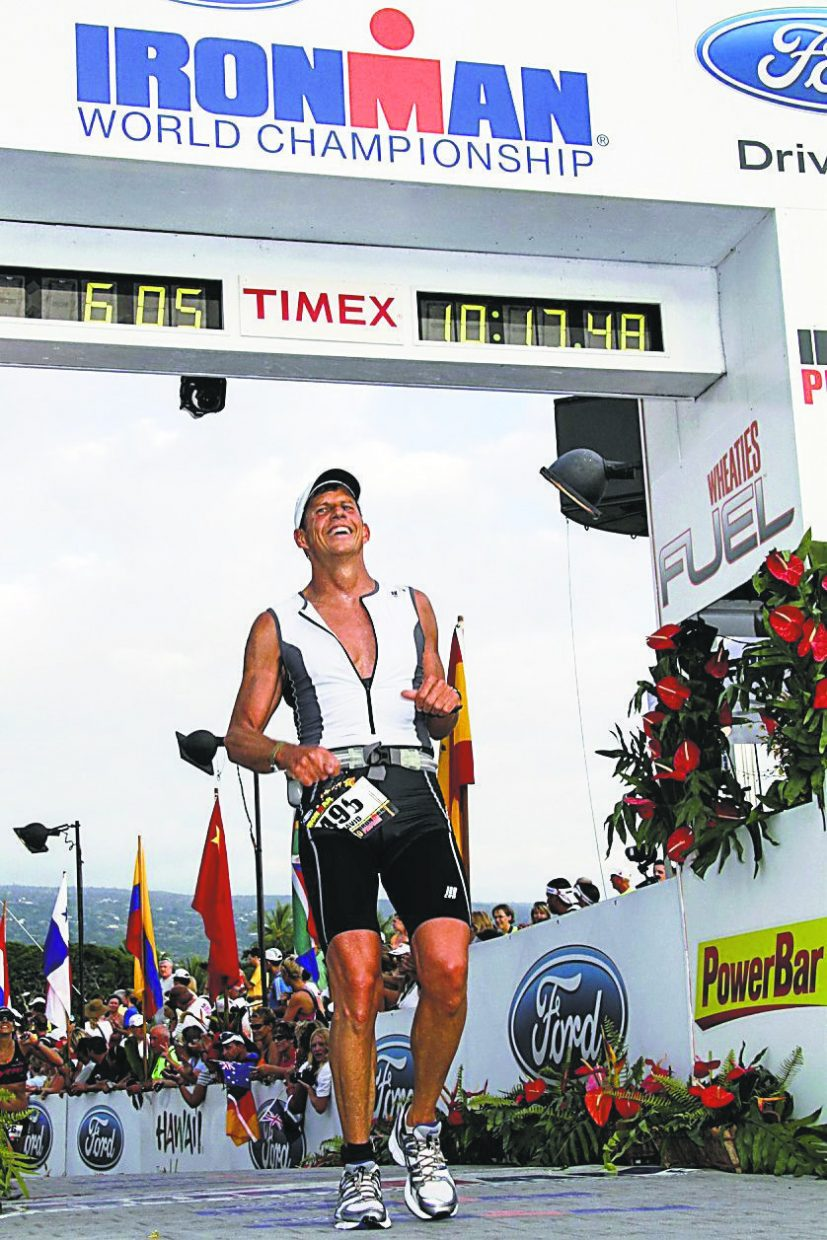 Carbondale resident Dave Clark crosses the finish line at Ironman World Championships on Oct. 11 in Kona, Hawaii. Clark finished in 10 hours, 17 minutes 32 seconds, placing fifth in his 55-to-59 year-old age group..