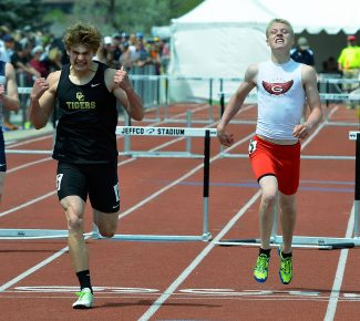 Glenwood Springs High School's Kaden Weller, right, crosses the finish line behind Canon City's Trenton Stingari during the 300-meter hurdles final of the Class 4A State Championships in Lakewood on Saturday.