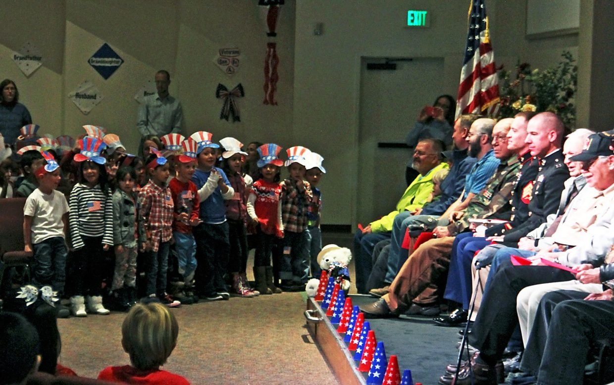 Veterans watch from the stage Wednesday as Crystal River Elementary School students perform to honor them on Veterans Day.