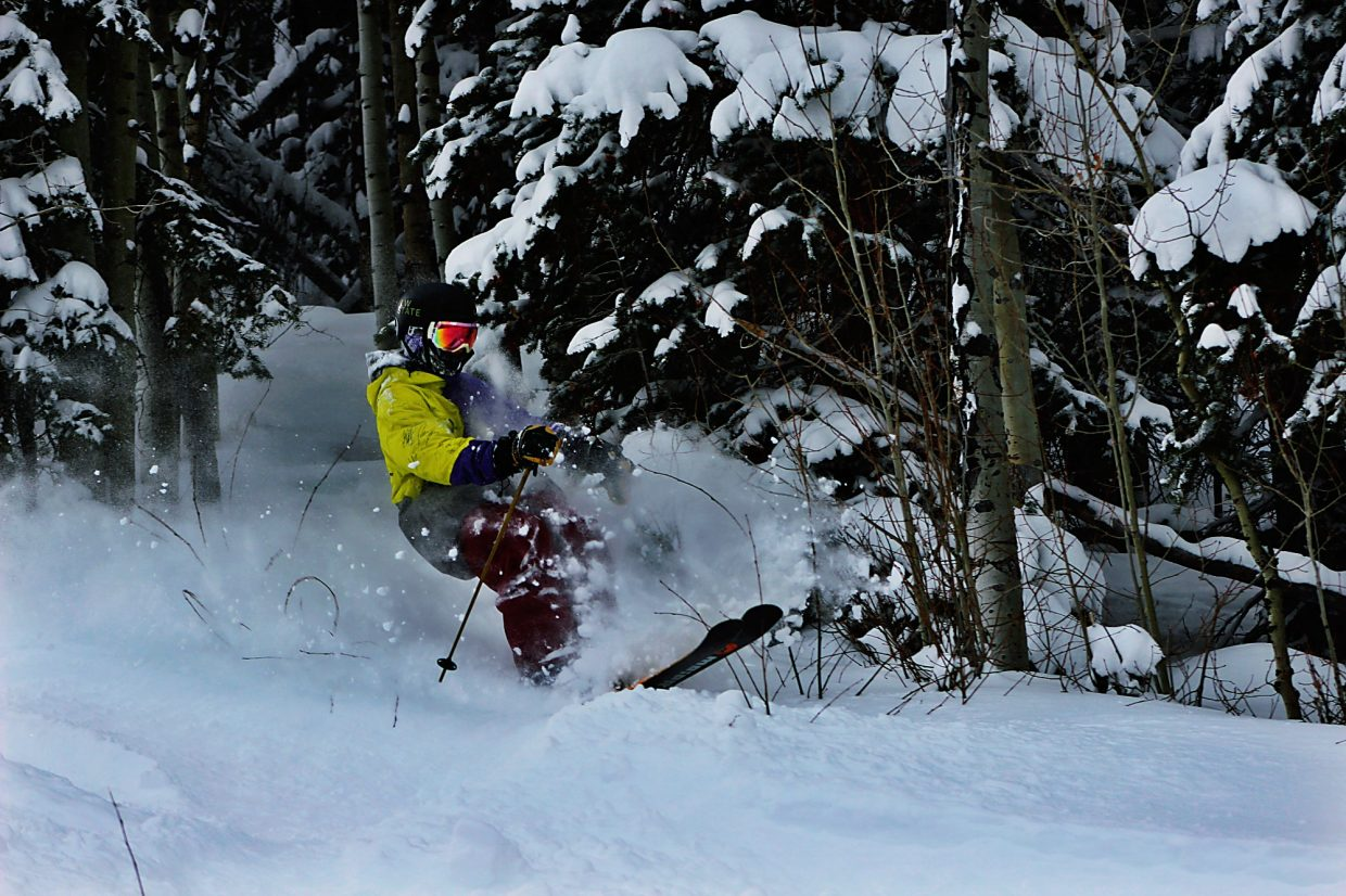A skier kicks up powder Tuesday at Sunlight Mountain ski area, which had a foot of new snow.