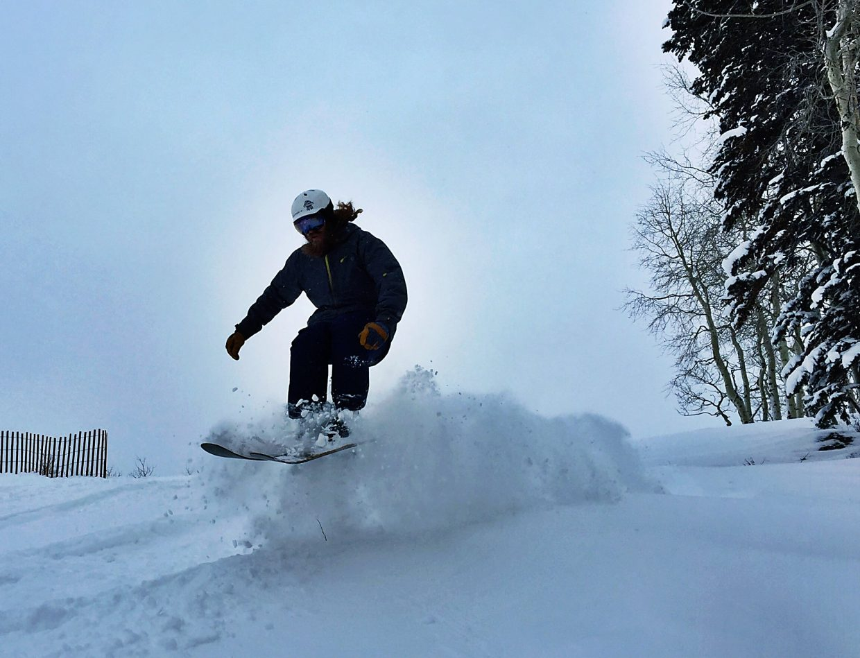 A snowboarder enjoys the foot of new snow Tuesday at Sunlight Mountain.