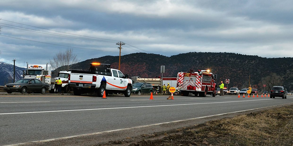 Emergency and CDOT vehicles surround Wednesday morning's accident scene on Highway 82 at Cattle Creek.