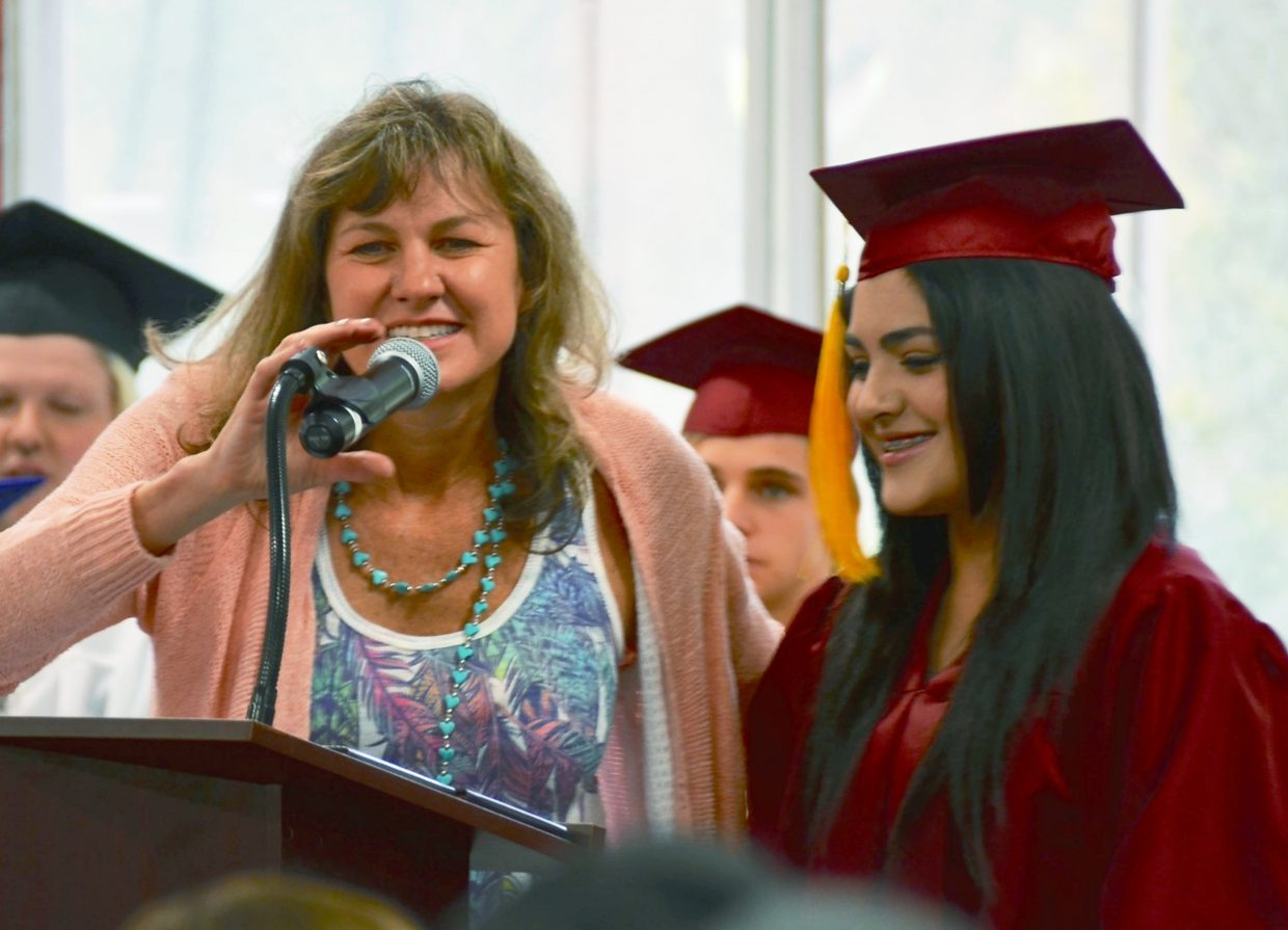 Stephany Ortega, right, received both the Alpine Bank Hispanic Scholarship and the Fast Forward Scholarship at Yampah Mountain High School's commencement ceremony at the Glenwood Springs Community Center on Friday.