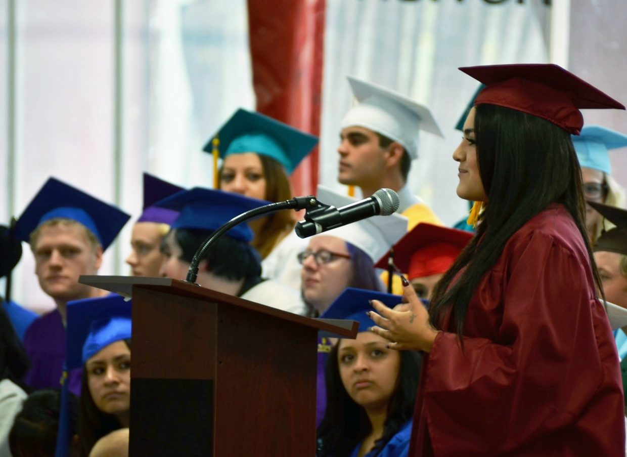 Stephany Ortega, winner of two scholarships, addresses classmates and audience members at  the Yampah Mountain High School commencement ceremony at  the Glenwood Springs Community Center on Friday.