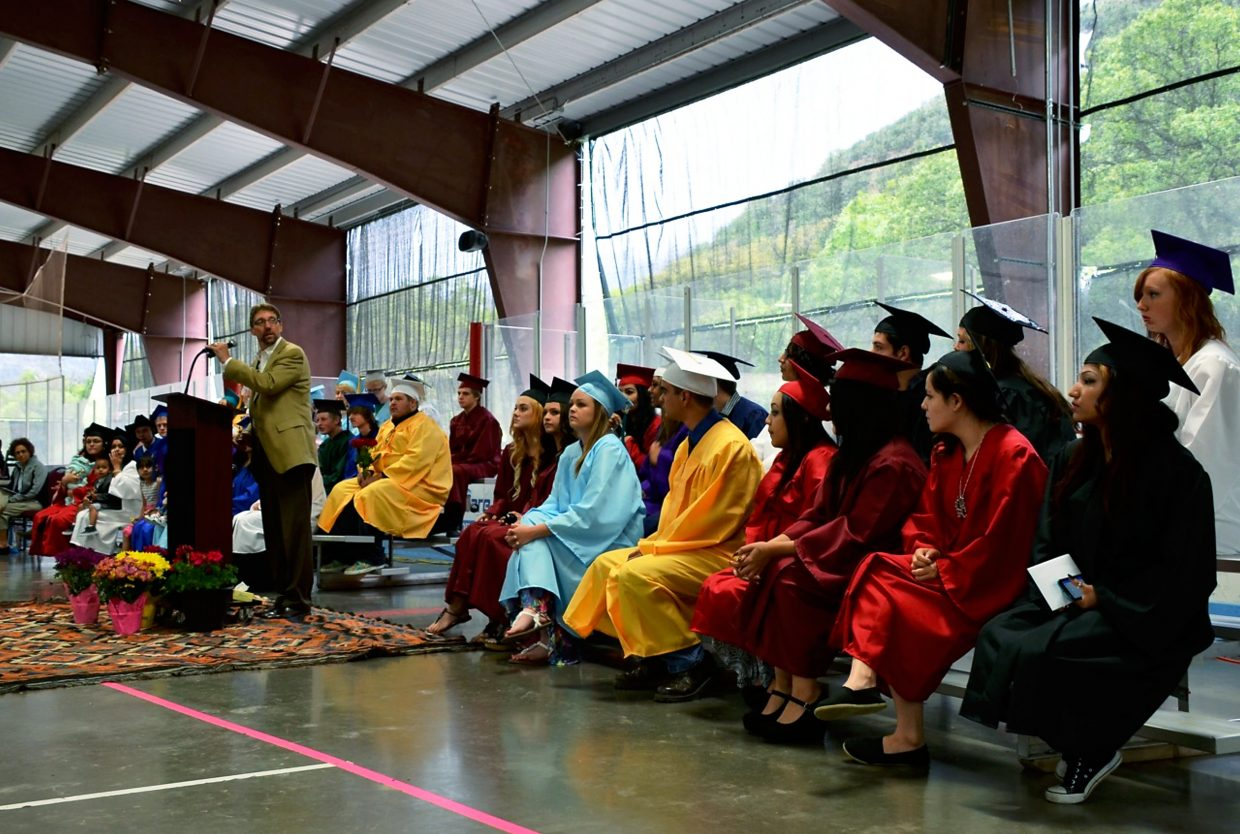 Yampah Mountain High School's executive director Troy Lange gives welcoming remarks at the graduating class of 2015's commencement ceremony in the ice rink at the Glenwood Springs Community Center on Friday.