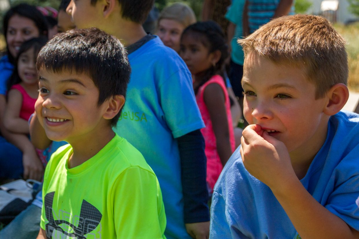 Nathan Fuentes and Zane Borem wait anxiously as the Classic Air Medical helicopter from Valley View Hospital lands during the last day of their Summer Advantage camp at Sopris Elementary. The kids got to look around and inside the helicopter as well as a fire truck and ambulance.