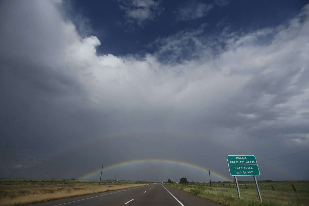 ADVANCE FOR USE TUESDAY, JULY 5, 2016 AND THEREAFTER-In this June 30, 2016 photo, a rainbow arcs in the sky on the road from Pueblo, Colo., to Rocky Ford, Colo., in Otero County. Two different economic worlds are writ large in Colorado. It is among the states with the greatest economic gap between urban and rural areas, according to an Associated Press review of Economic Innovation Group data; Virginia, South Carolina and Florida are the others. (AP Photo/Brennan Linsley)