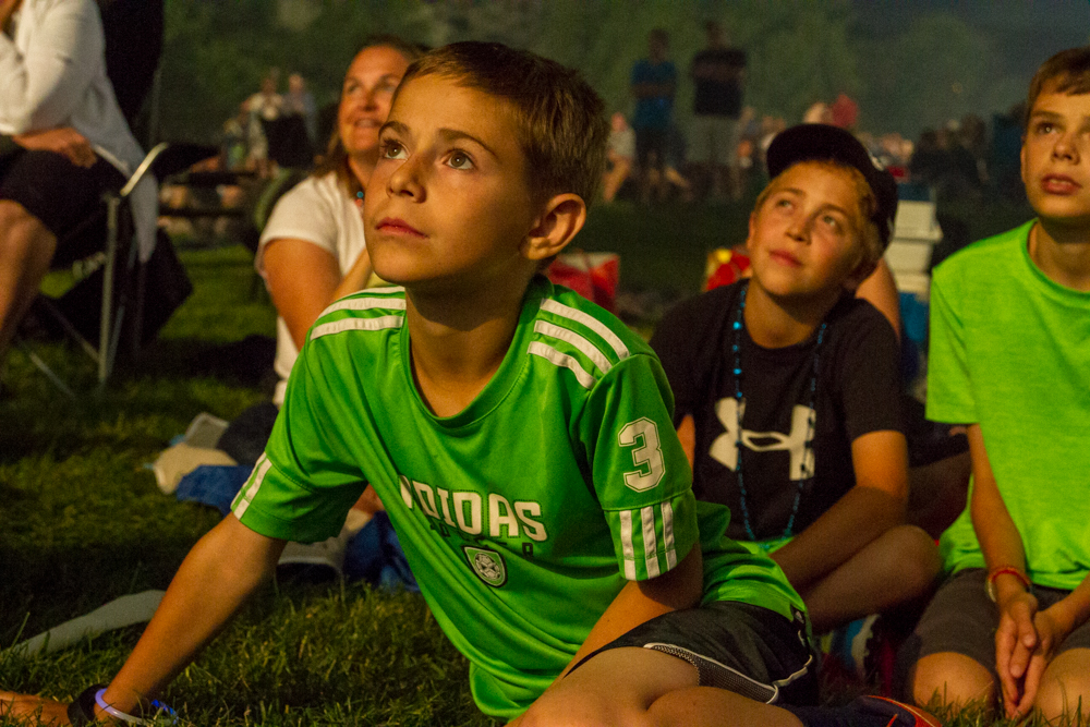 10-year-old Keenen Coe and friends watch the fireworks display at Two Rivers Park during the Fourth of July celebration.