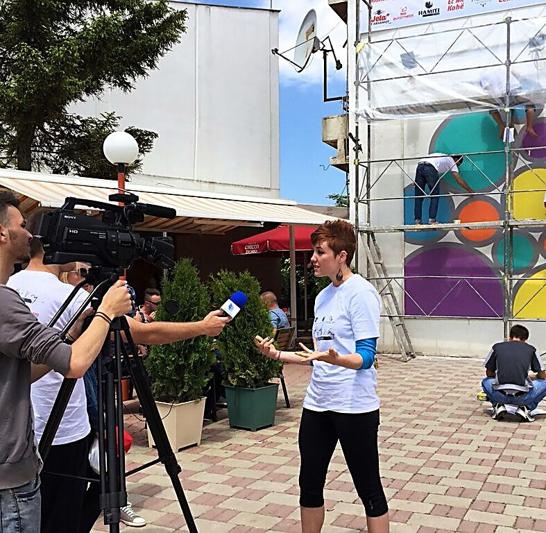 Mary Wade, a Rifle native and U.S. director of Colorado + Kosovo Project, talks with the media in Viti, Kosovo, in 2015.