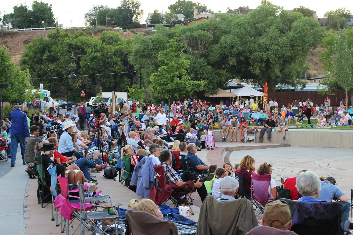 Rifle residents and visitors take in a show at Centennial Park, where the city hosted its annual July 3 fireworks display.