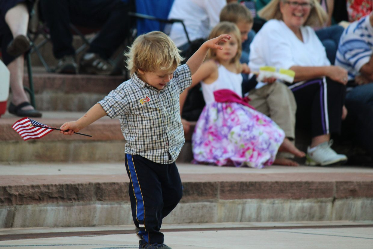 Chase Kocman, 2, dances in Centennial Park as Symphony in the Valley performs at Rifle's July 3 celebration.