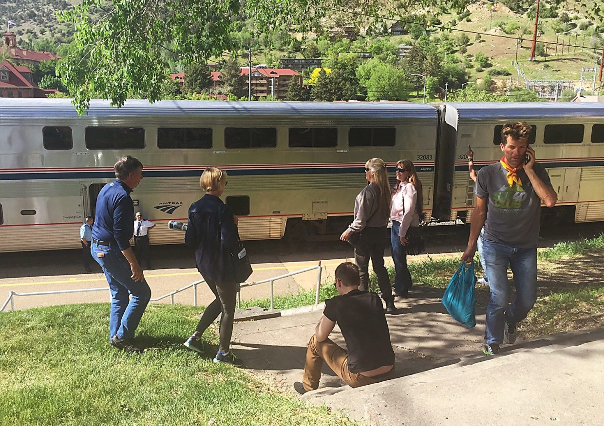 Amtrak passengers figure out their next step Tuesday after being brought back to Glenwood Springs following their train's collision with a pickup truck just west of town.