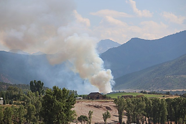 Smoke rises from the wildfire Friday along the lower Crystal River Valley.