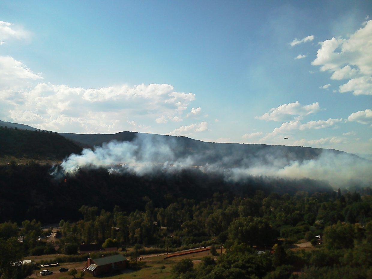 Smoke rises Friday from a wildfire near Sustainable Settings south of Carbondale.