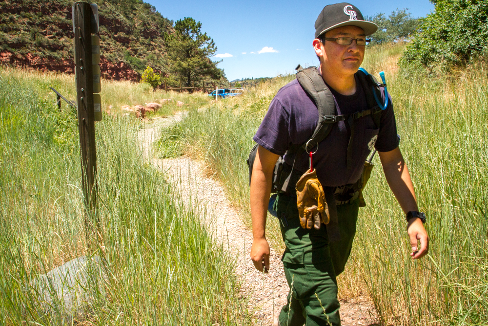 Firefighter Marteen Herrera with the Upper Colorado River Interagency Fire Managment Unit hikes the Storm King Mountain trail during the hottest part of the day Wednesday with a heavy pack on his back in honor of the 14 men and women who died fighting the South Canyon Fire on July 6, 1994.