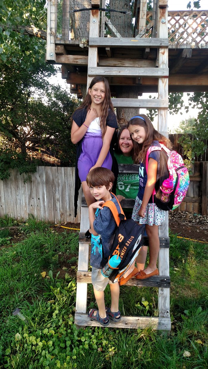 The Glynn children pose for a photo with mom, Jennifer. From back to front: McAllister, eighth grade at Rifle Middle School; Delaney, fourth grade at Graham Mesa Elementary School; and Will, second grade at Graham Mesa.