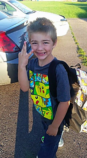 Marek Burns holds up three fingers before his first day of third grade at Graham Mesa Elementary. Marek recently moved to the area from Texas, and said that Mrs. Macnab is the nicest teacher ever.