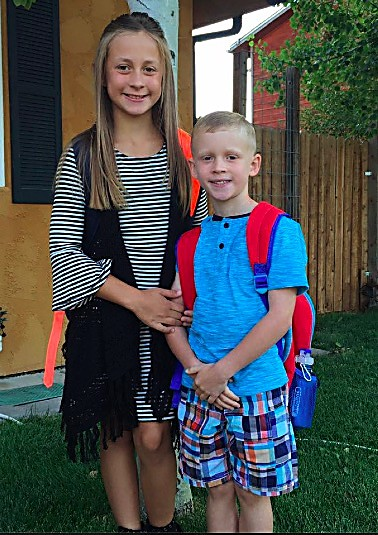 Eliana and Treycen Smith smile before heading off to Highland Elementary School. Eliana is entering fourth grade, while Treycen is starting kindergarten.
