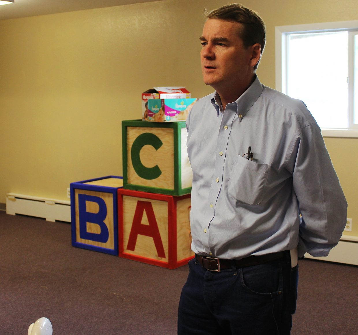 U.S. Sen. Michael Bennet tours Caring Kids Preschool in Rifle Monday.