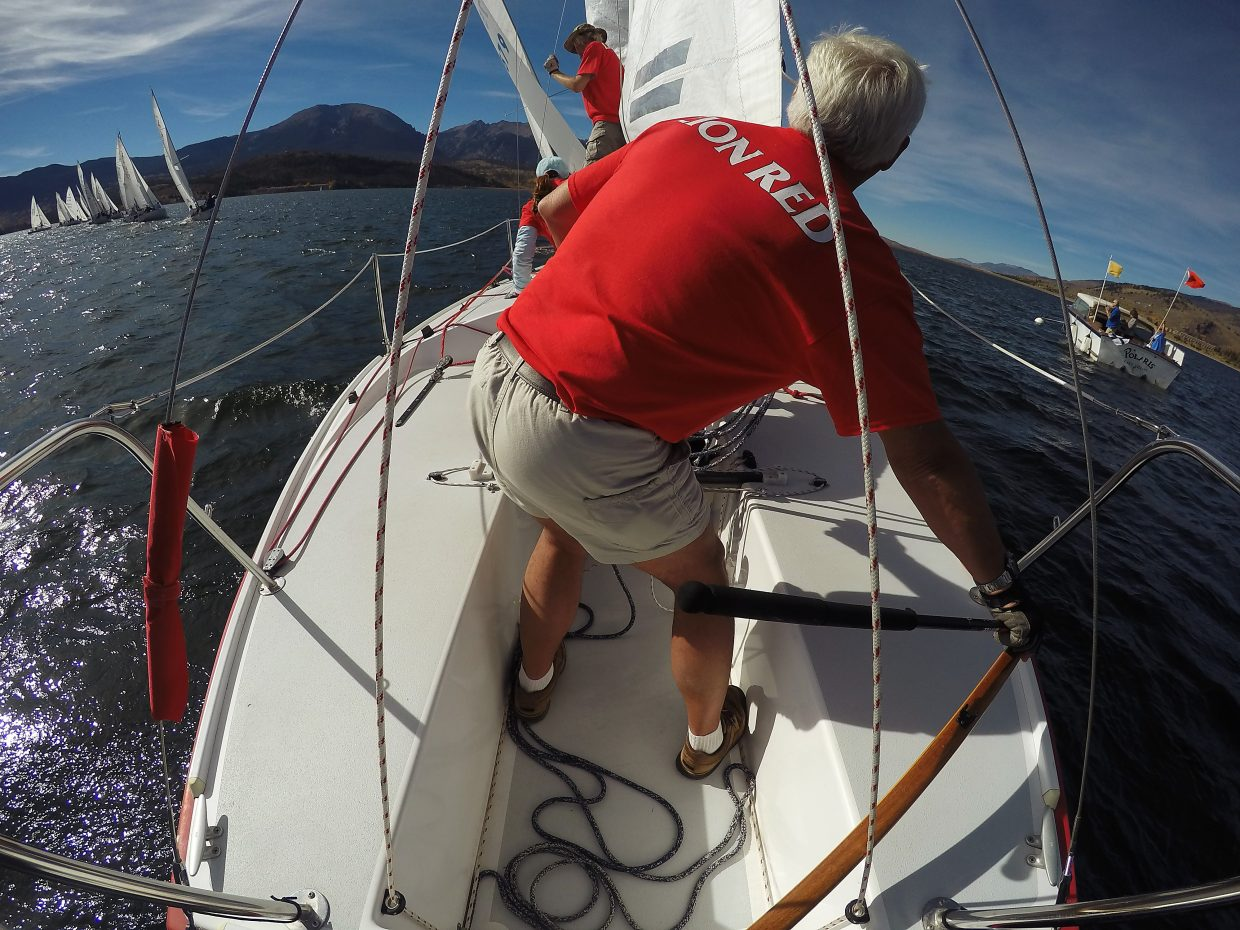 On the deck of a J22 sailboat at Lake Dillon with Colorado Escapist host Shawna Henderson.