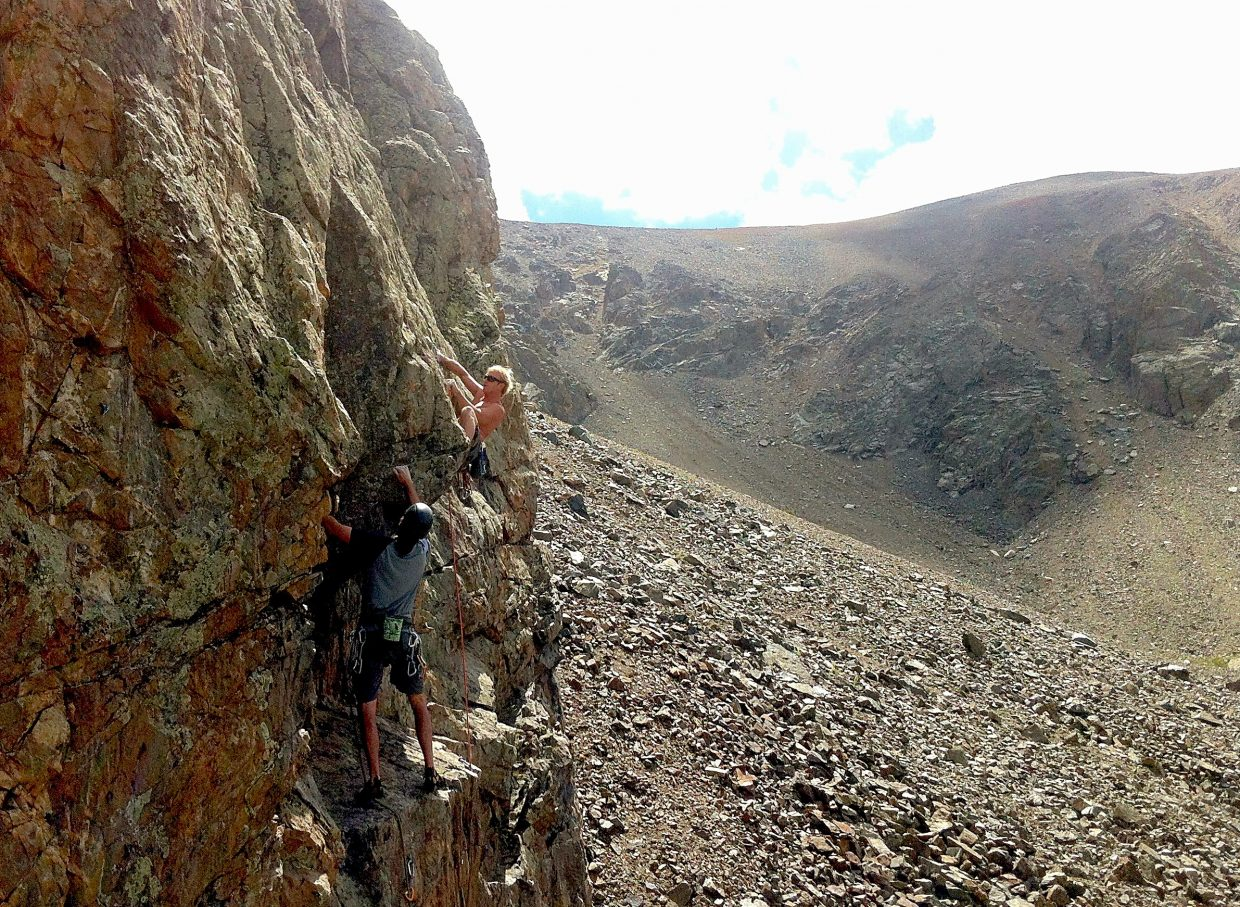 Climbers on the sport routes at Black Mountain Crag high atop Arapahoe Basin, a long-held secret for locals. The crag is home to routes from 5.8 to 5.11d.