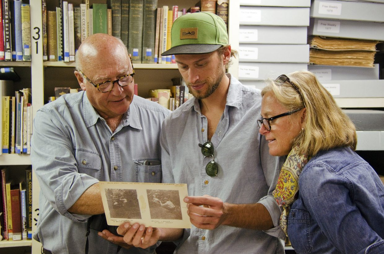 The Bucklins examine Frontier Historical Society files during their visit to Glenwood Friday.